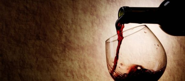 Red Wine glass and Bottle on a old stone background